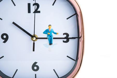 58748991 - businessman sitting on the clock